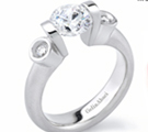 The Classic Setting has six prongs holding a round brilliant above a slender band