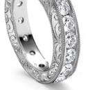 with richly carved and pierced mountings encrusted with diamonds