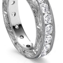 richly carved mountings, with matched or graduated round or square stones or with center stone round or square and pear-shaped side stones
