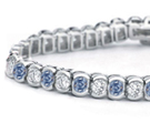 Platinum or gold flexible flat bracelets, set entirely with matched or graduated marquise, pear, square, oblong or round brilliants with small diamons intervenin; also cabochon emeralds, sapphires or rubies with small diamonds intervening.... each 500. to 15,000.