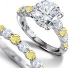 Rose-cut diamonds accent the yellow and oxidized white gold floral Buccellati band