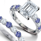 A sapphire design classic from R. Eiserian features a cushion-cut and diamond side stones