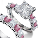 a 6.1-carat radiant-cut fancy intense pink diamond with two trapezoid white diamond side stones mounted in platinum and 18k pink gold