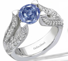 A delicate nineteenth-century ring from R. Eiserian has a sapphire at the center of a diamond square