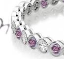 Gold chain bracelets, ornamental links with diamonds, set in platinum at spaced intervals