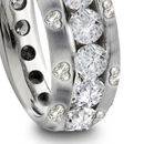 with two round or pear-shaped diamonds at sides in simple, plain, grooved, fluted, or wxquisitely carved mountings