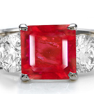 Shop for Ruby Rings - A stunning ring showcases an emerald-cut and tapered baguettes.