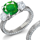the ring bears either an emerald or a sapphire