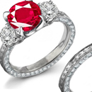 A triple split shank paved in diamond adds extra flash to Stephen Russell's oval-cut diamond ring