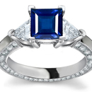 A stunning ring showcases an emerald-cut and tapered baguettes