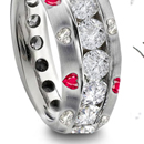 Neil Lane specilizes in vintage engagement rings and he chose a platinum Edwardian ring with three large diamonds.