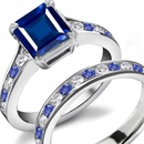 Sleek tapered baguettes hug an emerald-cut in a Scott Kay ring