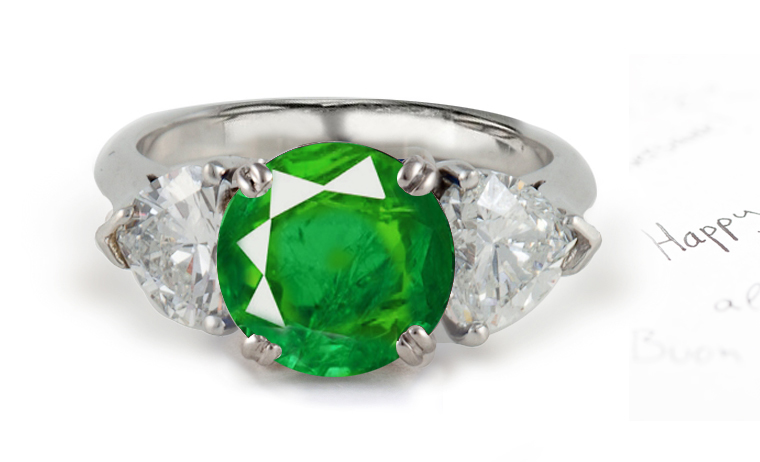 center emerald and diamonds engagement ring