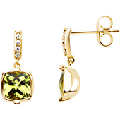 genuine green cushion cut peridot earrings bezel set in real gold and suspended from a small gold diamond shank