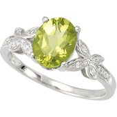 genuine peridot solitare ring with two floral mounts embracing the peridot and studded with diamonds in real white gold