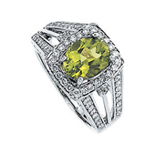 oval cut genuine green peridot and diamond halo ring witha split shank accented with diamonds in real white gold