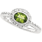 genuine green peridot ring with a halo of diamonds around the centerstone and diamonds on the shank in real white gold