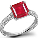 Ships From New York Jewelry Store - Two trillion side stones attend to a princess in a confident H. Stern ring