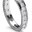 The stone is encircled by a halo of smaller round diamonds that flicker and sparkle inside the vintage setting