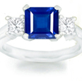 Princess Blue Sapphire Three Stone Ring with Diamonds in 14k White Gold (7X5 mm)