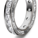 surrounded by a border of diamonds in cut down platinum settings and double left shank set with diamonds