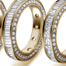 consisting of various shapes and forms of all diamonds, or allied with other gem stones, cut to form pattern in close pave settings or richly pierced free and open designs