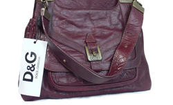 Maroon Color Premier Designer Dolce and Gabbana Leather Handbag imported  from Italy. Measurements  10